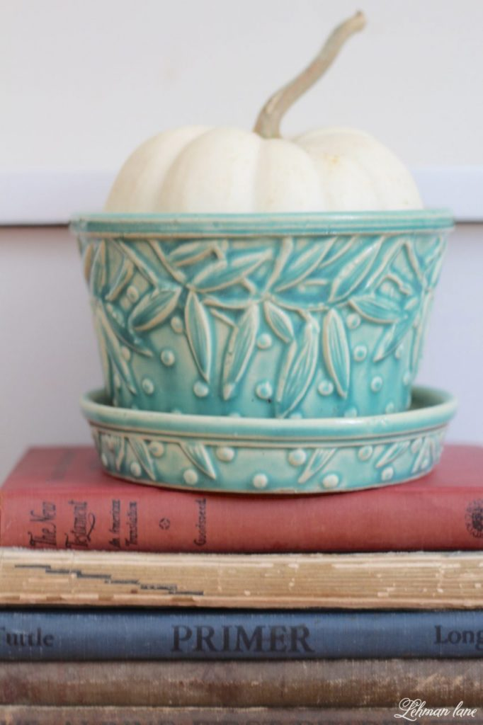 Powder Room Refresh - with pops of green - pumpkin, McCoy pot, vintage books