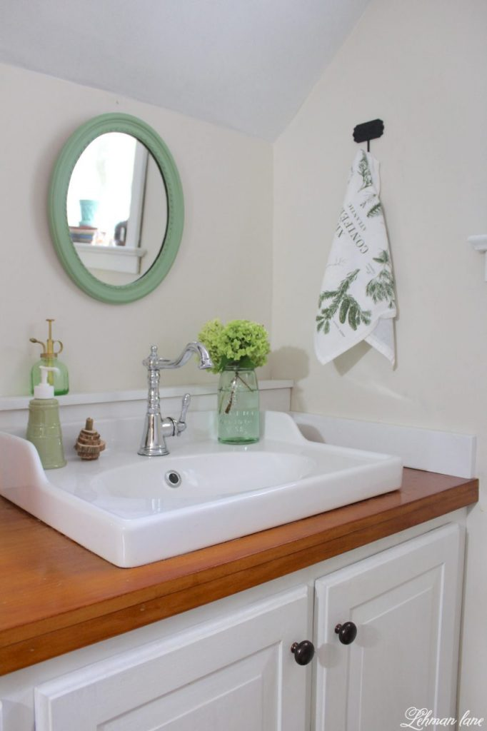 Powder Room Refresh - with pops of green - sink and mirror