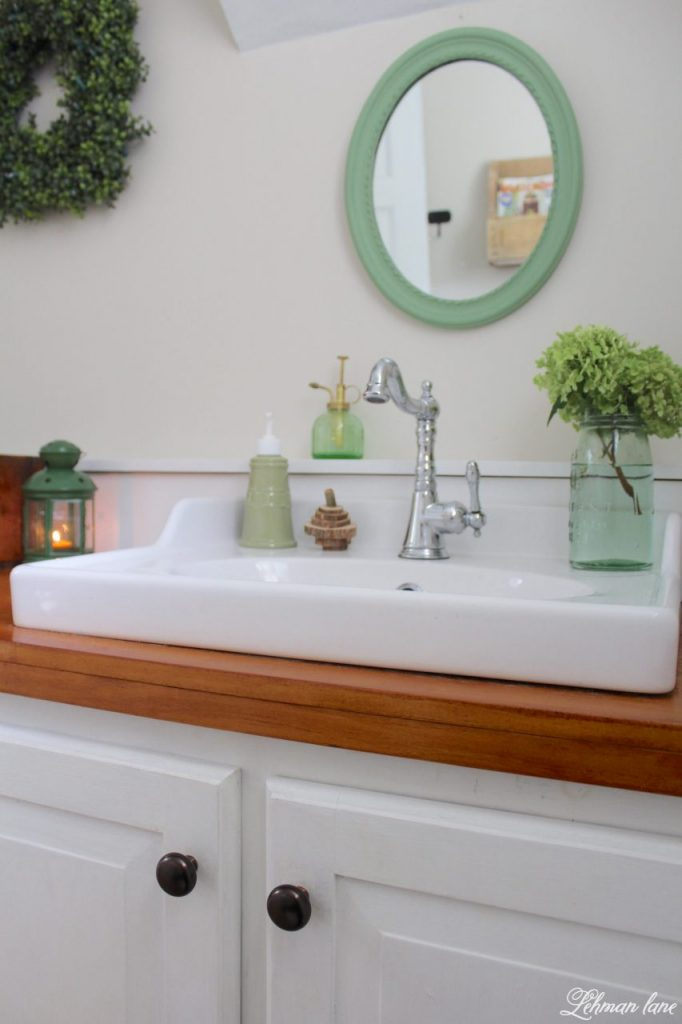 Powder Room Refresh - with pops of green #powderroom #bathroomrefresh #budgetbathroom http://lehmanlane.net