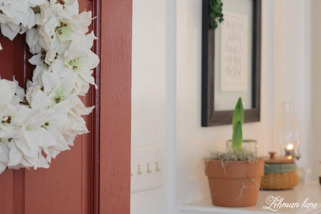Christmas Entryway - built in entryway table, white wreath, amaraylis bulb