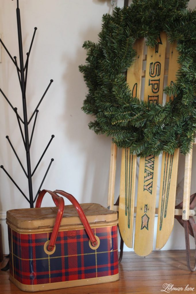 Christmas Entryway - tartan box, vintage sled, mitten drying rack