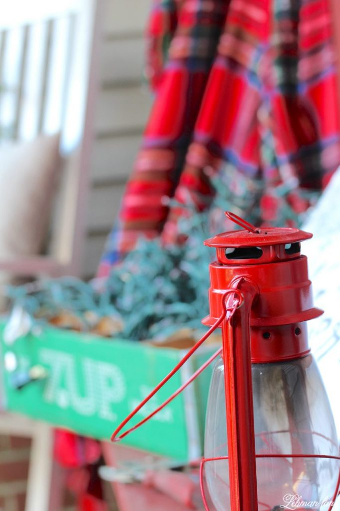 Christmas Home Tour - red hurricane, green crate, red plaid blanket