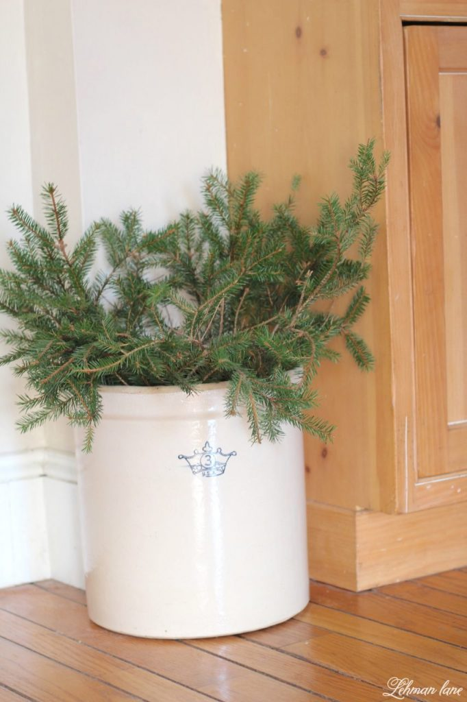 Christmas Home Tour - kitchen crock with greenery