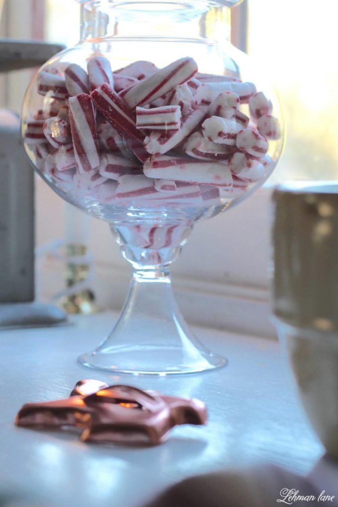 Christmas Home Tour - peppermints in a glass jar and copper cookie cutters
