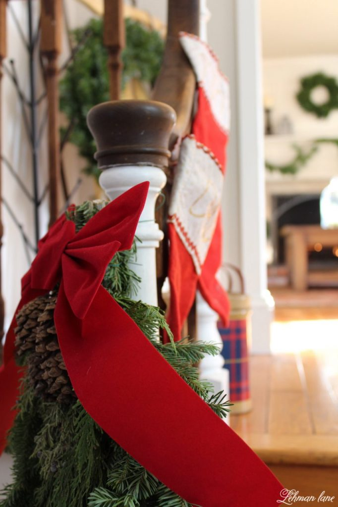 Christmas Entryway - farmhouse stairs, garland and red