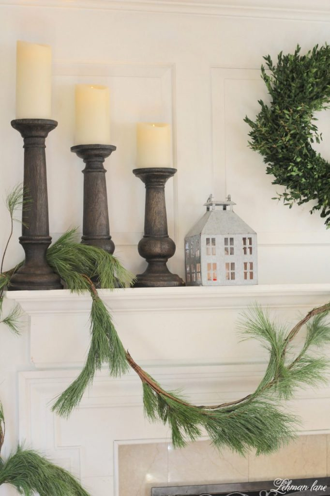 Green and White Christmas Mantel - pine garland, zinc house, balsam hill candlesticks and faux candles