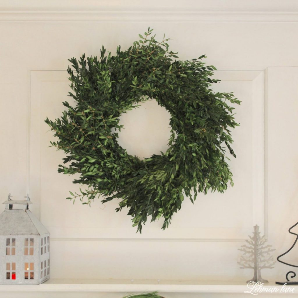Green and White Christmas Mantel - fresh boxwood wreath from Trader Joe's