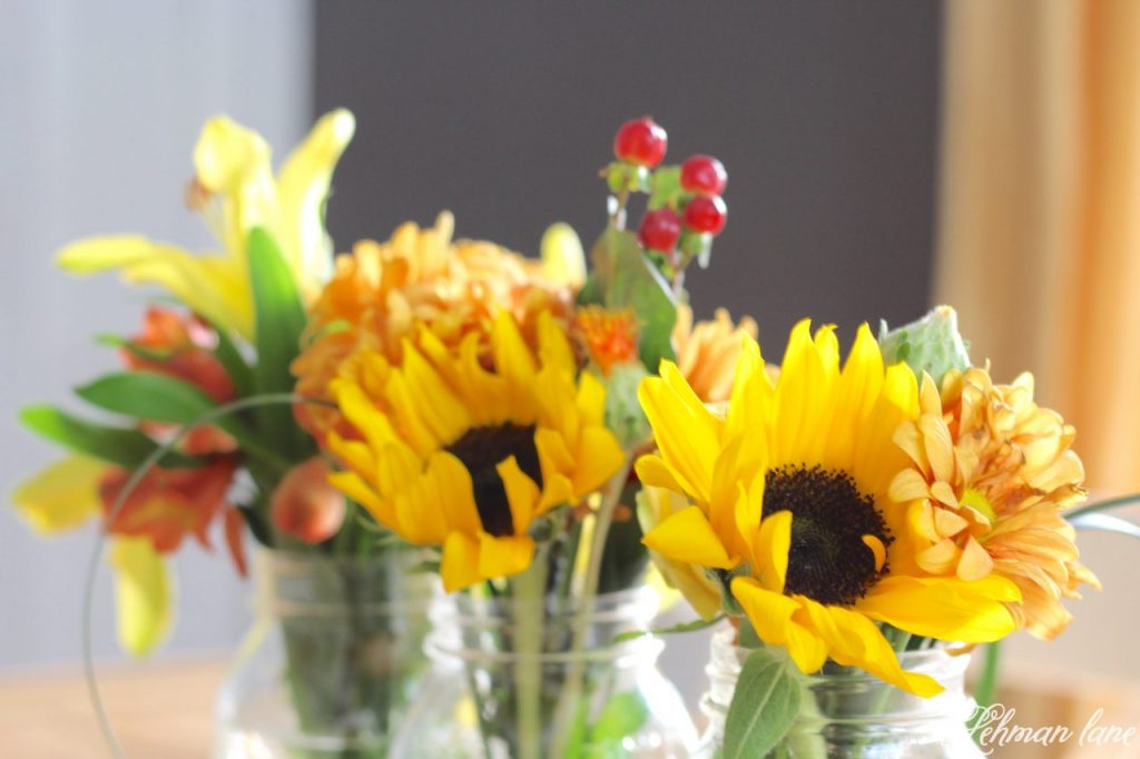 Simple Flower Arrangement - ball jars on farmhouse table for fall