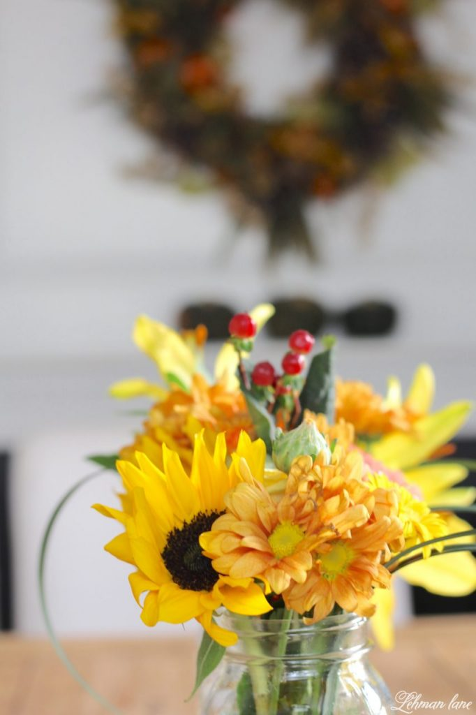 Simple Flower Arrangement - sunflowers and fall flowers in mason jars on my farmhouse table for fall