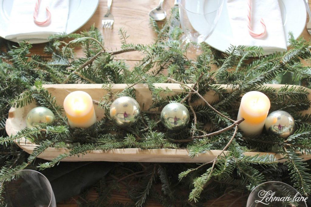Christmas Tablescape - farmhouse table, candles and christmas balls in a dough bowl