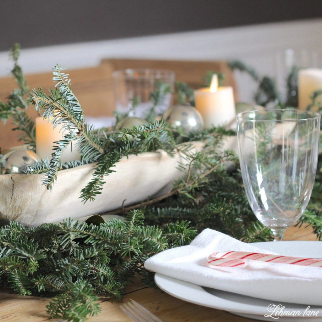 Christmas Tablescape - fresh greenery, dough bowl and candles on our farmhouse table