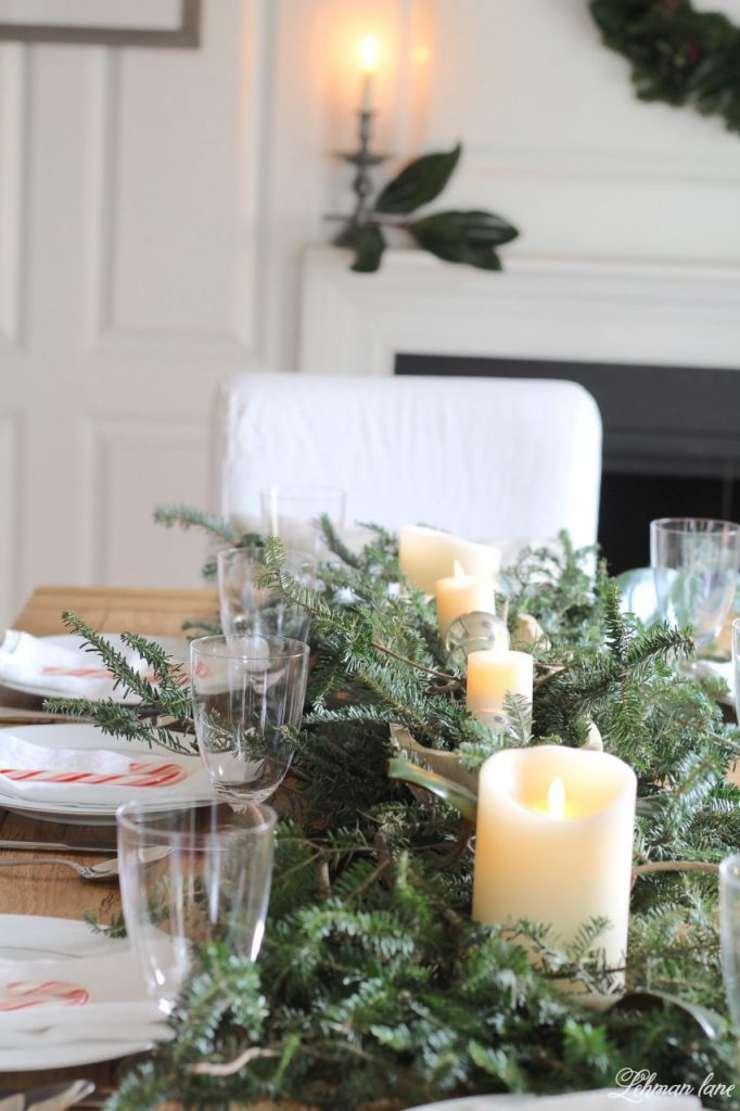 Christmas Tablescape - fresh greenery centerpiece, farmhouse dining room