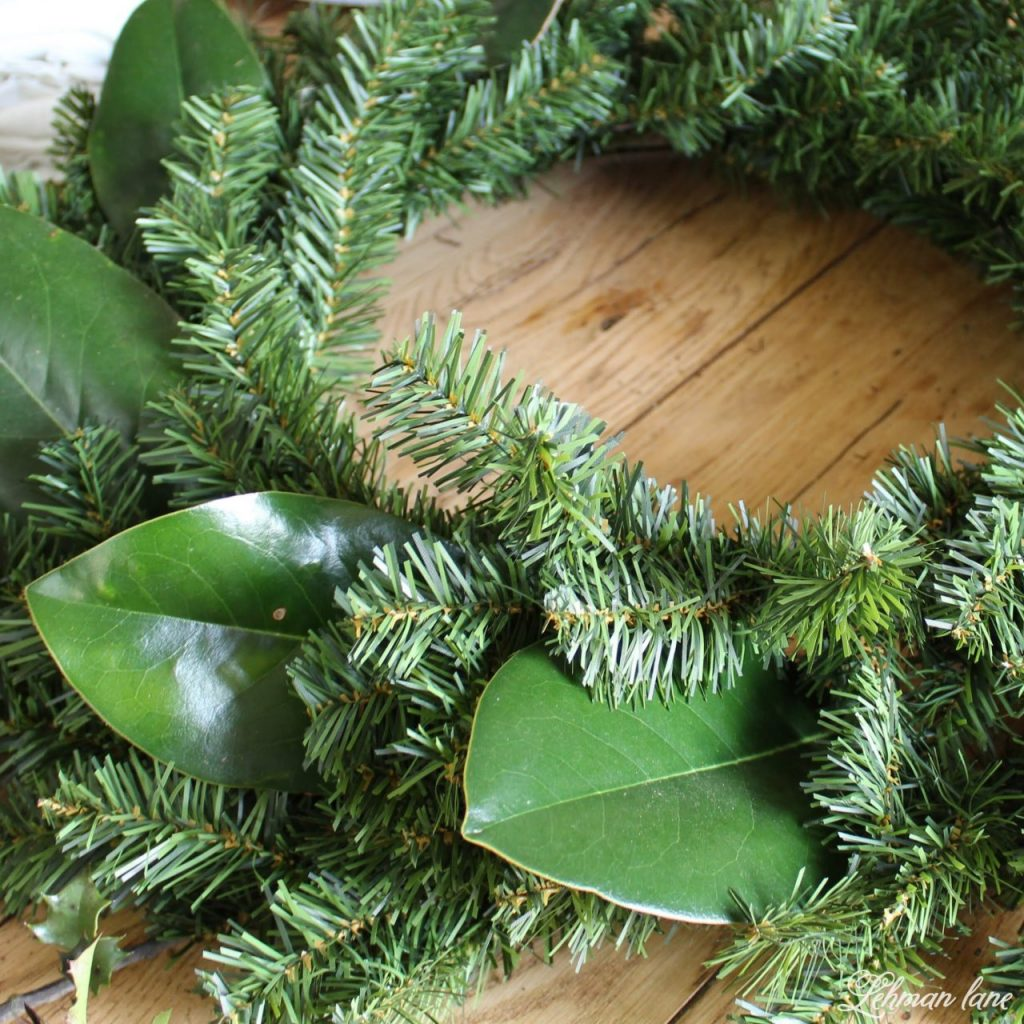 DIY Simple Christmas Wreath - no glue gun required and in less than 10 mins! adding magnolia leaves