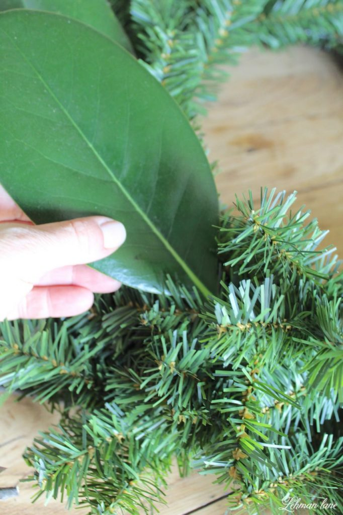 DIY Simple Christmas Wreath - adding magnolia leaves