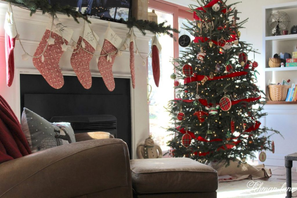 Happy Christmas Eve Eve Eve :).  Before all the Christmas wrapping, teddy bear bread making, and holiday punch drinking was over I wanted to share our family room Christmas tour and talk a little bit about all the Christmas tree craziness at our farmhouse this year.