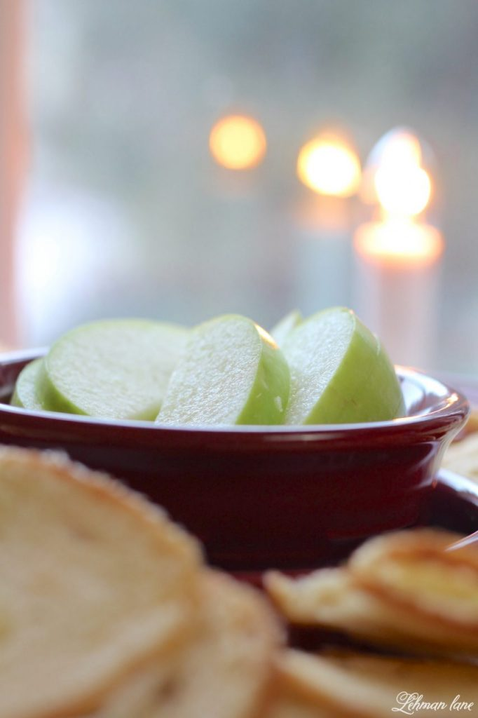 Simple Baked Brie with Strawberry Jam - sliced green apples and french bread crustini