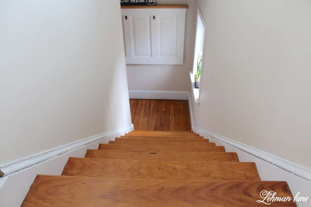 DIY - Refinishing Our Farmhouse Stairs - looking down to our old door turned coat rack