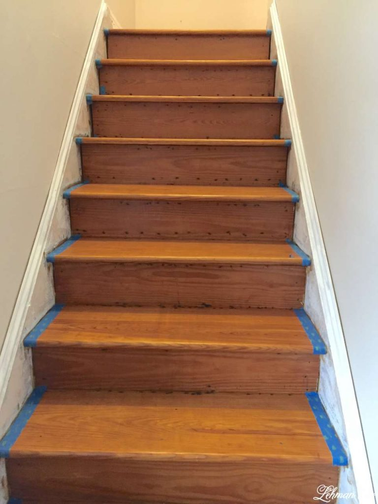 DIY - Refinishing Our Farmhouse Stairs - taping the stairs