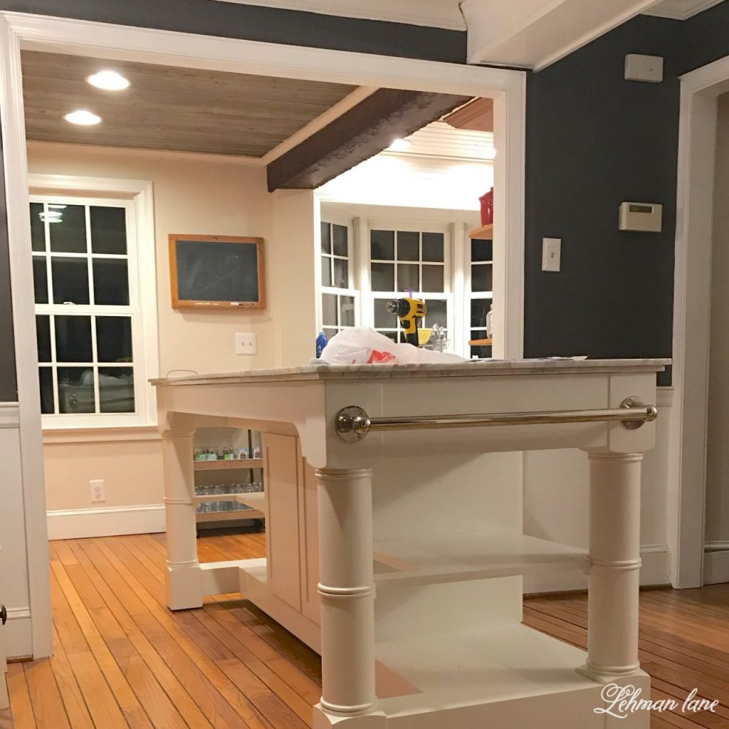 I am happy to announce we are more than halfway through our kitchen remodel and we have a new kitchen island, woo hoo! - before wall in dining room