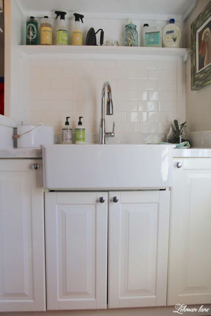 Laundry Room - Tiling and Organziation - sink and cabinets, white subway tile and carrara marble tile counters