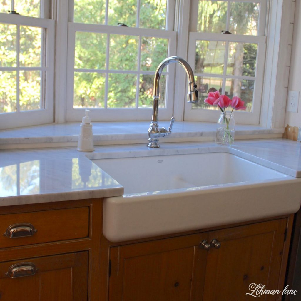 I am sharing our new GORGEOUS farmhouse sink and faucet for our kitchen. Woo Hoo!!! I can not believe what a difference this sink makes to our kitchen remodel. sink over pine cabinets