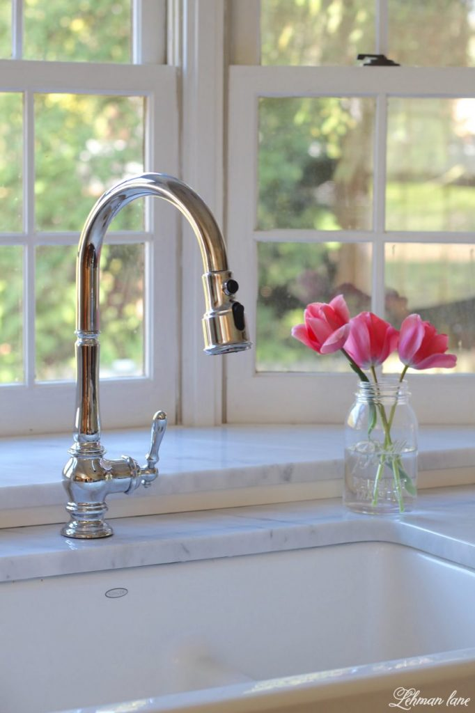 I am sharing our new GORGEOUS farmhouse sink and faucet for our kitchen. Woo Hoo!!! I can not believe what a difference this sink makes to our kitchen remodel. #farmhousekitchen #farmhousesink