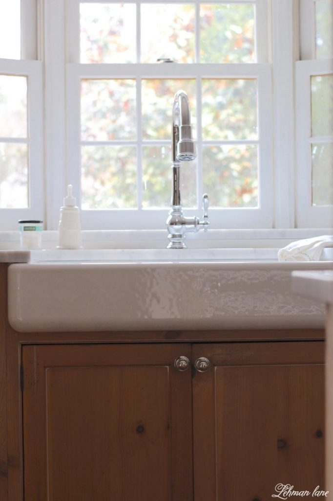 I am sharing our new GORGEOUS farmhouse sink and faucet for our kitchen. Woo Hoo!!! I can not believe what a difference this sink makes to our kitchen remodel. kohler whitehaven sink with pine sink base cabinet