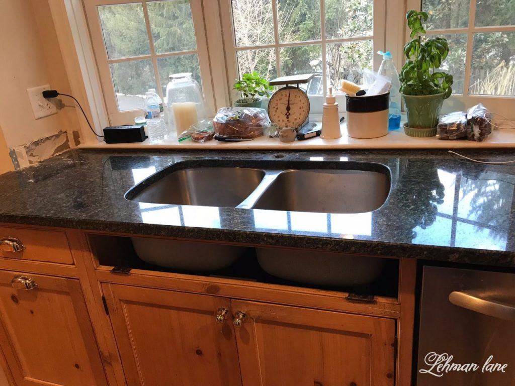 I am sharing our new GORGEOUS farmhouse sink and faucet for our kitchen. Woo Hoo!!! I can not believe what a difference this sink makes to our kitchen remodel. sTaking off part of the sink base to make room for the new farmhouse sink