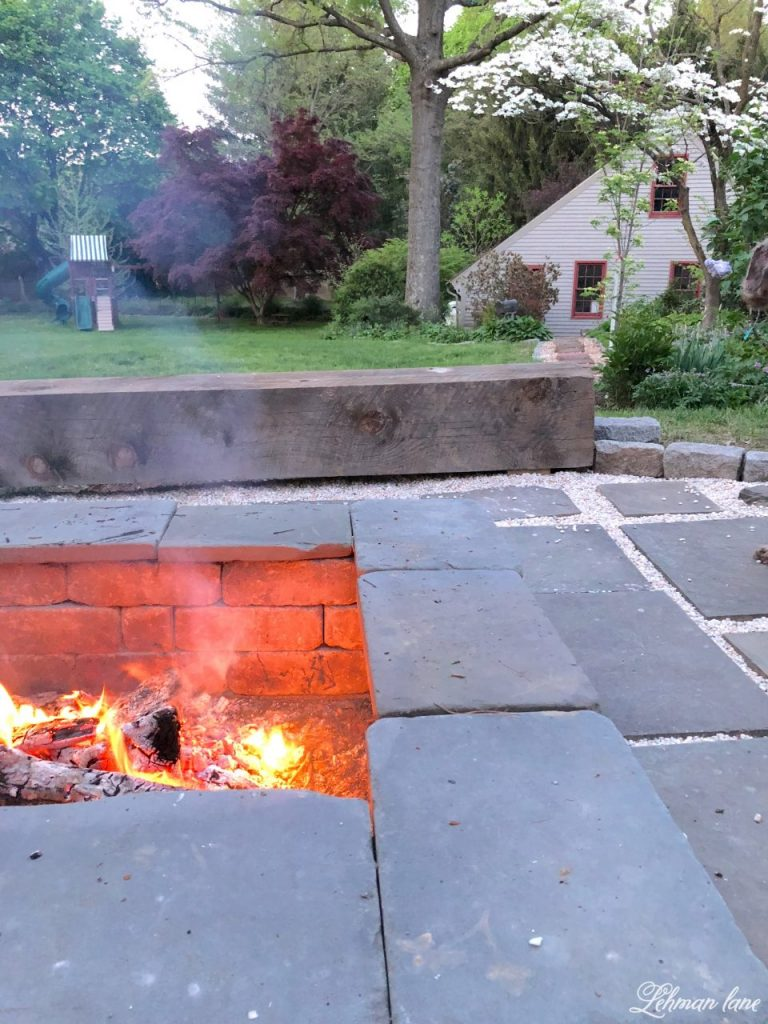 Just a few short years ago we created a stone fire pit. It is one of our family's favorite spots to hang out in our backyard, especially when we have large parties. We recently gave our fire pit an upgrade for less than $100 in just one day! Check out our gravel fire pit makeover!