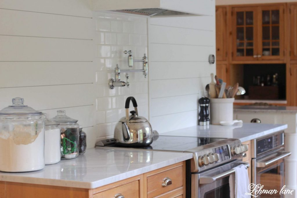 Carrara Marble Countertops & a Review - Today I am sharing our new carrara marble countertops and talking about why I decided to get them despite everyone around us looking at alternative countertops.  Our new marble countertops have truly transformed the look of our farmhouse kitchen and I could not be happier with the beauty they give to our space. #marble #carraramarble #marblecontertops #carraramarble #kitchencountertops http://lehmanlane.net