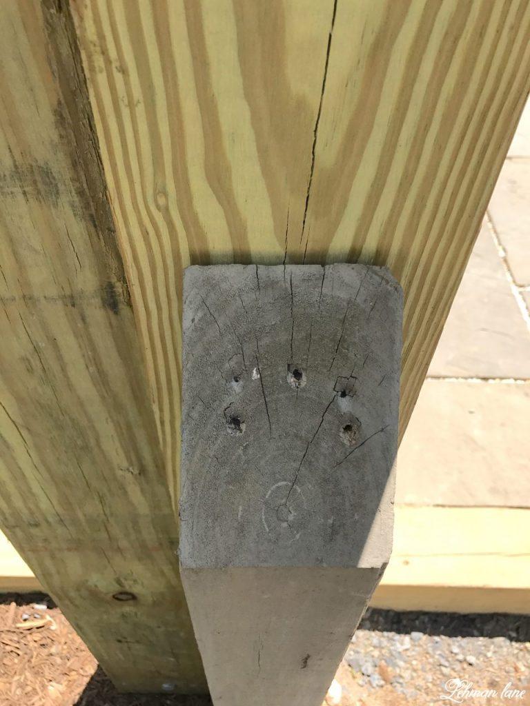 DIY Wooden Arbor - screwing in the posts