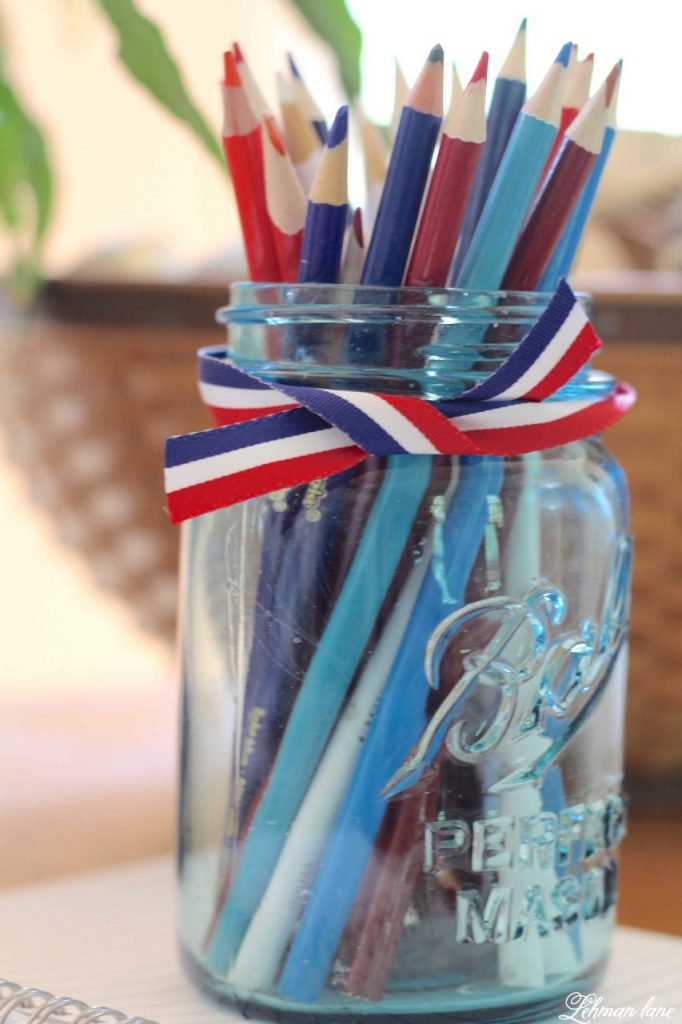 Farmhouse 4th of July Decorating is as simple as you make it. It calls for a collection of vintage & unexpected red, white & blue items from around your home, hydrangeas & of course old glory!   Sharing  ideas of how I decorate our farmhouse for free for the Independence Day! Colored pencils in ball jar #4thofjuly http://lehmanlane.net