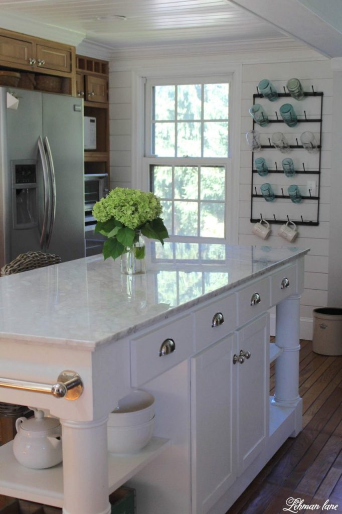 Farmhouse Kitchen Makeover Reveal - The time has FINALLY come to share our farmhouse kitchen makeover!We wanted a brighter, bigger, more modern, family friendly kitchen that we could entertain in. Ten months later and for less than $15,000 we remodeled this kitchen from top to bottom and I CAN NOT believe the difference! #farmhousekitchen http://lehmanlane.net