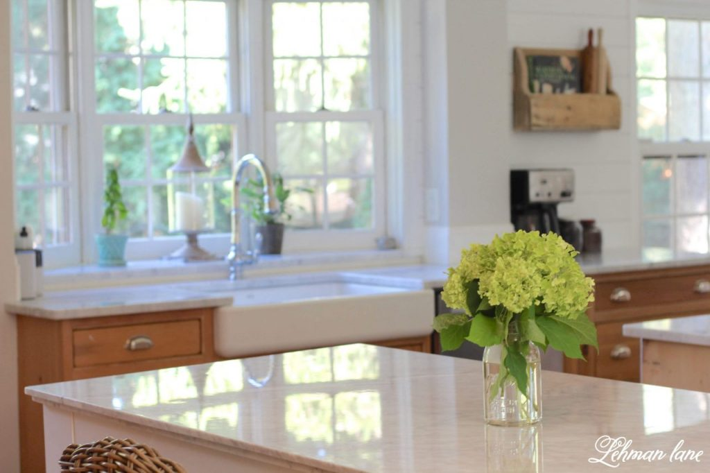 Farmhouse Kitchen Makeover Reveal - The time has FINALLY come to share our farmhouse kitchen makeover! We wanted a brighter, bigger, more modern, family friendly kitchen that we could entertain in. Ten months later and for less than $15,000 we remodeled this kitchen from top to bottom and I CAN NOT believe the difference! #farmhousekitchen http://lehmanlane.net