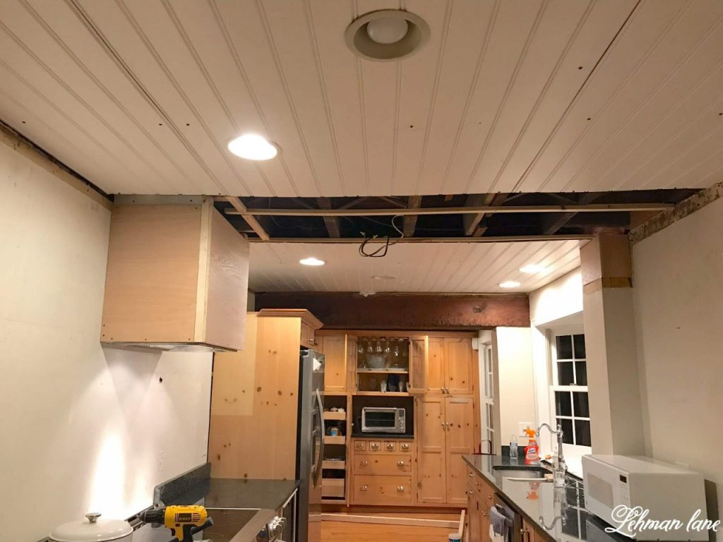 Taking Down the Faux Beam & Faux Wood Ceiling - These days people are adding faux beams to their ceilings but today I am sharing why we decided to take down the faux beam and faux wood ceiling in our farmhouse kitchen. #fauxbeam #beadboard http://lehmanlane.net
