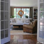 I have long wanted to paint the doors in our family room white. Painting the doors and trim white allowed for more neutral decorating, a more cohesive feel from room to room and makes our family room feel brighter and bigger.  Stop by to check it out #familyroom #whitepaint http://lehmanlane.net