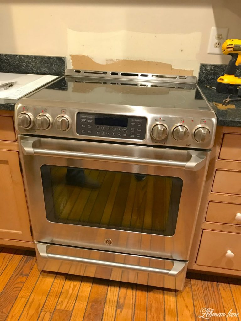 New Electric Range With Wall Unpainted