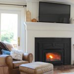 Wood Stove Insert - Last year we were left with a broken pellet stove and had to make the tough decision of whether to buy another pellet stove or switch to a wood stove insert.  In the end, we decided to get a wood stove insert & today I am sharing why we decided to. #woodstove #fireplace http://lehmanlane.net