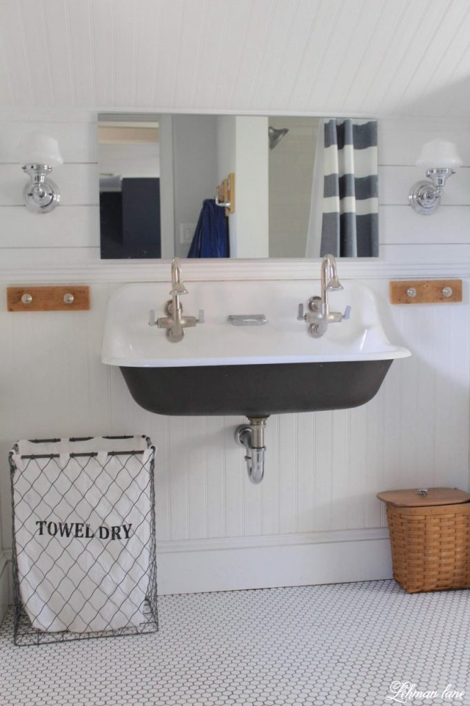 Shiplap in the Boys Bathroom - Our boys bathroom received a small makeover with a new mirror & shiplap walls. It was a simple & inexpensive update that we finished in just a weekend! #shiplap #farmhousebathroom #boysbathroom http://lehmanlane.net