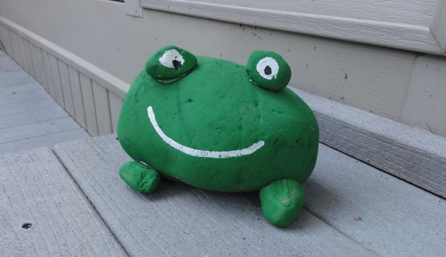 kids painted stone frog
