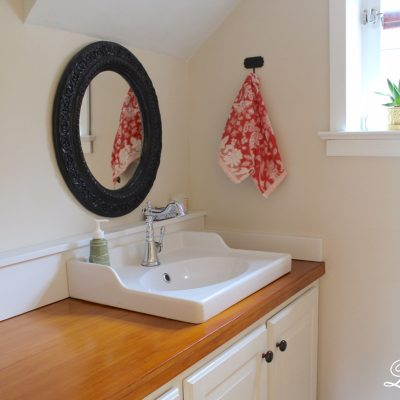 Come check out our newly finished powder room including how we created some wood countertops!