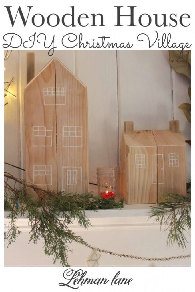 Sharing all the details of how to make a gorgeous DIY cedar post wooden Christmas house for your Christmas village decor for less than $20 with step by step instructions & pictures. And the best part is that you can customize these wooden Christmas house decor to match your existing home, past home, dream home... whatever! #christmascrafts #christmas #christmashome decor https://lehmanlane.net