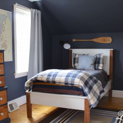 Come check out navy boys bedroom reveal. We completed gutted the room and added new ceiling, new floors, paint, built in desk and a new doorway. #boysbedroom https://lehmanlane.net