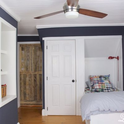 Final Reveal - Boys Farmhouse Bedroom, Built in bed, dresser, bead board ceiling, wide pine floors, Benjamin Moore Hale Navy walls, and an angled door #boysbedroom https://lehmanlane.net