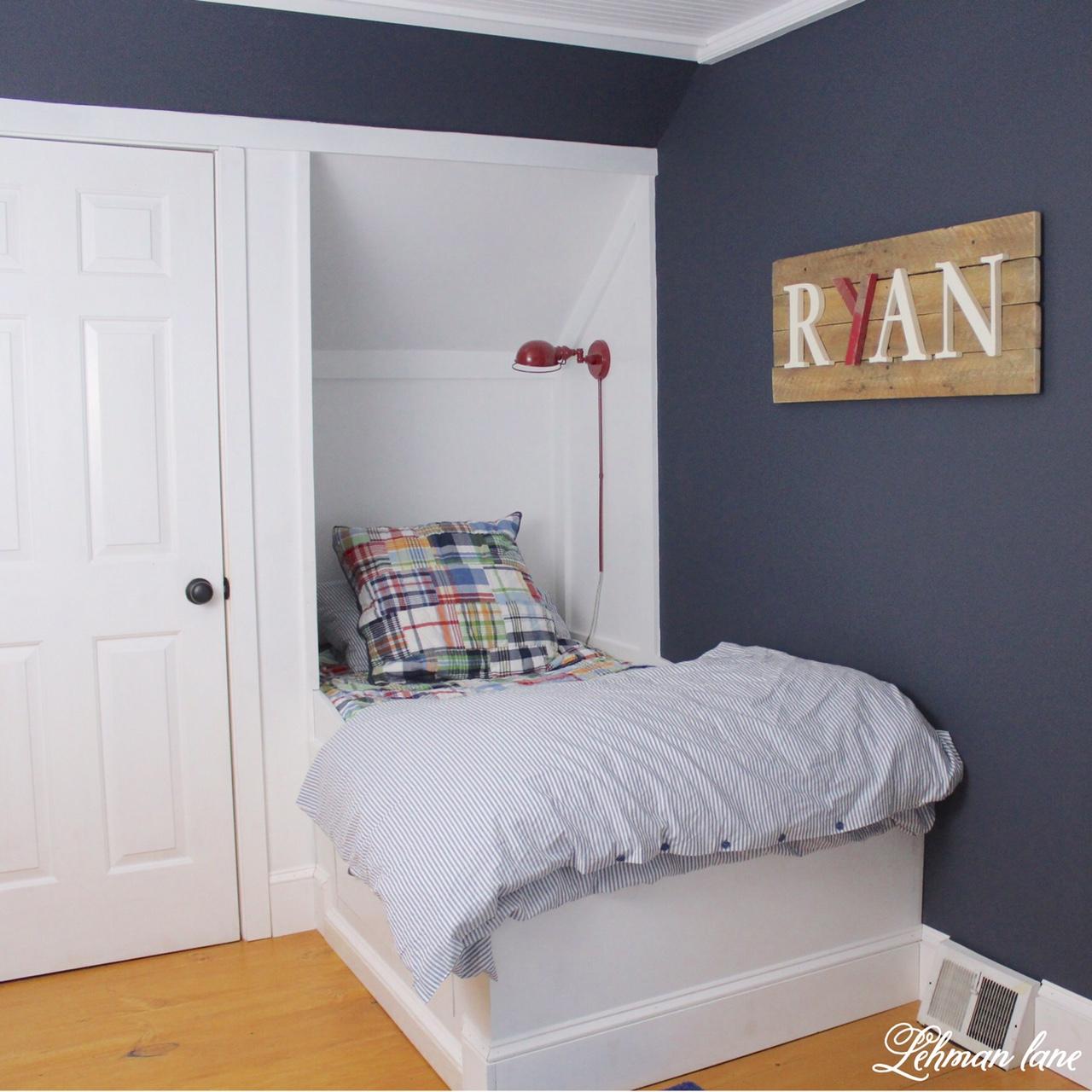 Final Reveal - Boys Farmhouse Bedroom, Built in bed, dresser, bead board ceiling, wide pine floors, Benjamin Moore Hale Navy walls, and an angled door