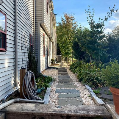 Sharing all the Details & Ideas of How we Built a DIY Stone walkway around our farmhouse with flagstone & pea gravel steps. #walkway #gardenpathway #diy #farmhouse #stone #stonestep #backyardideas https://lehmanlane.net