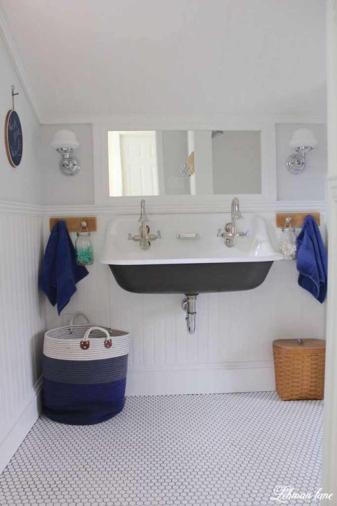 We transformed our boys bathroom from top to bottom - sherwin williams spatial white, vinyl bead board ceiling and walls and brockway sink #bathroom https://lehmanlane.net