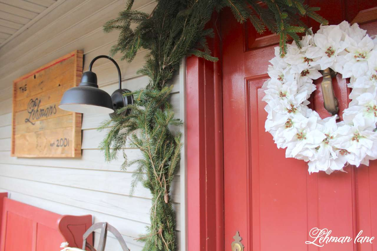 Farmhouse Christmas Home Tour - front porch, red door, white wreath