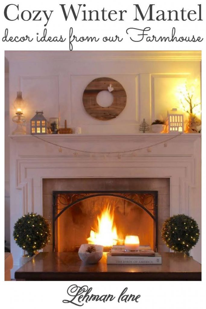 Sharing all my Tips & Tricks for How to Create a Cozy & Beautiful Winter Mantel Decor after Christmas for our living room fireplace mantel with white decoration ideas, garland & pictures.
