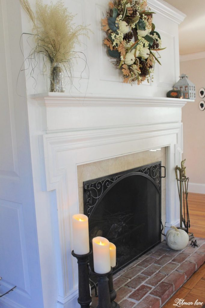 Splendor of Autumn Home Tour with Balsam Hill - living room mantel, heirloom pumpkin and magnolia wreath, LED candles and faux bois candle holder